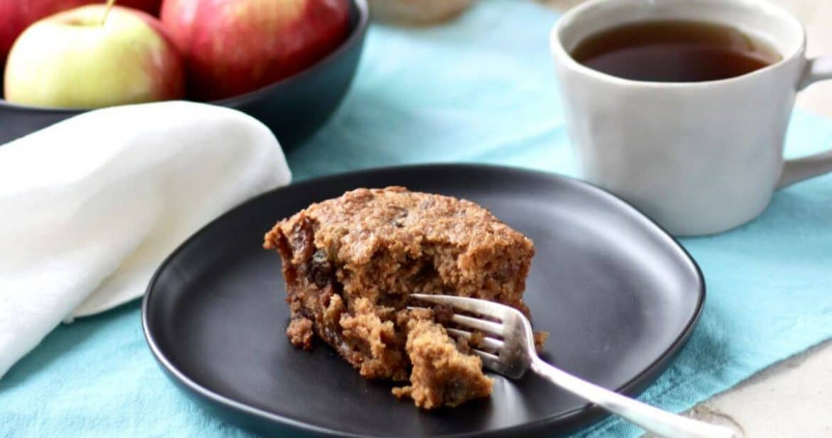 applesauce cake on dark plate with fork