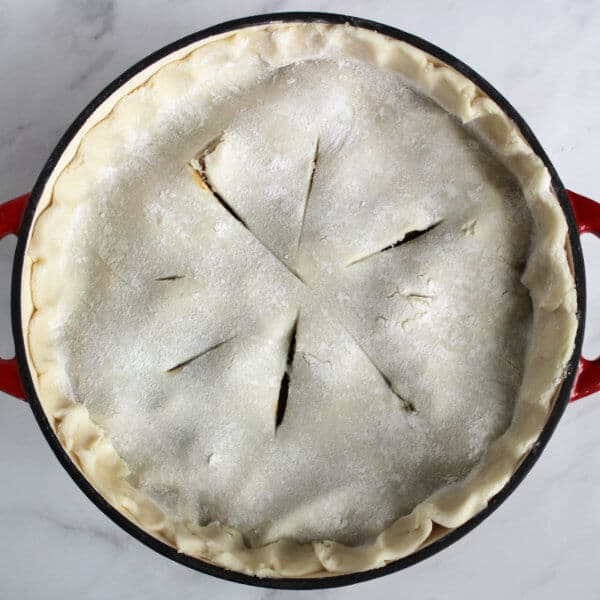 unbaked pie crust with slits cut in it