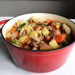 stewed beef, carrots, and potatoes in red pot