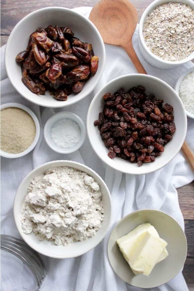 dates, oatmeal, raisins, flour, and butter in bowls