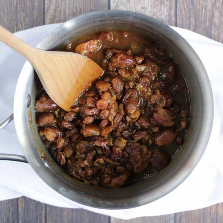 dates and raisins simmering in a pot of water