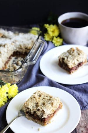 gluten free date squares, two served on white plates