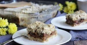 moist dates and raisins sandwiched between two layers of crumb pastry