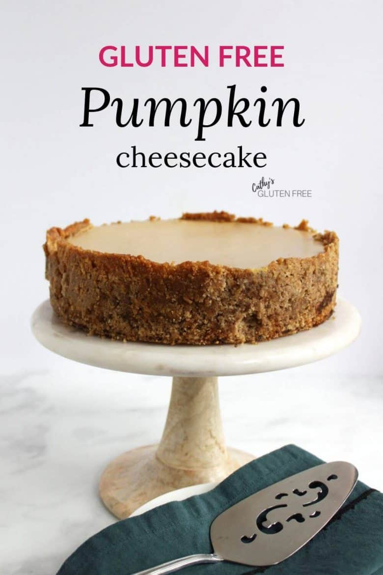 cheesecake with almond crust on marble pedistal