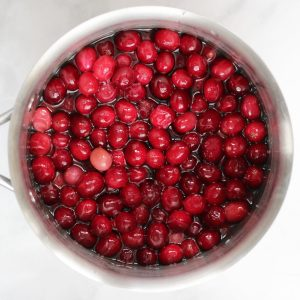 whole cranberries in stainless saucepan