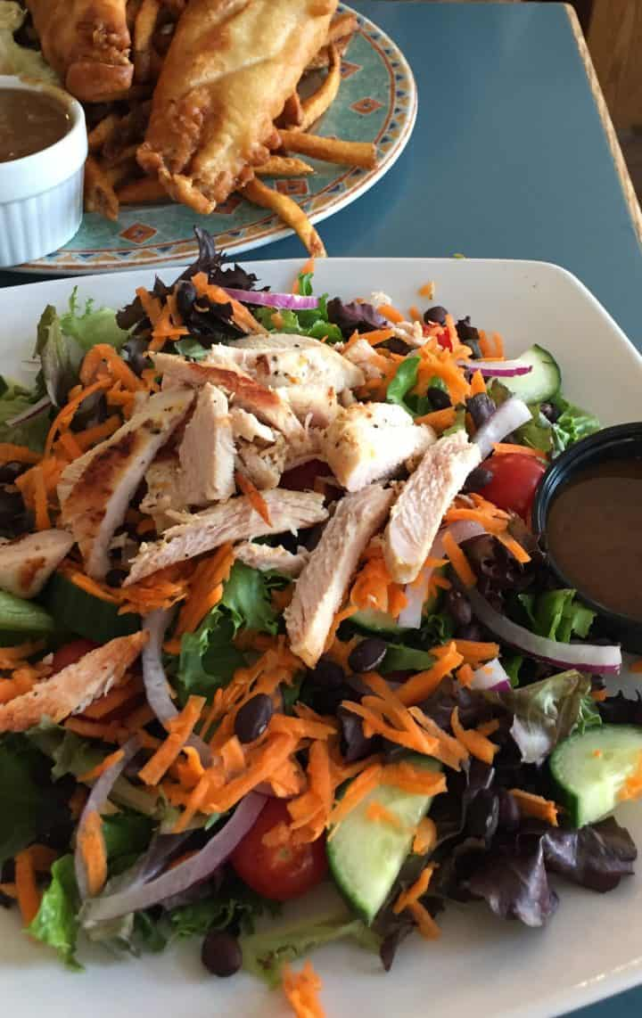 salad with strips of chicken breast on top, a frequent choice when I eat gluten free in restaurants