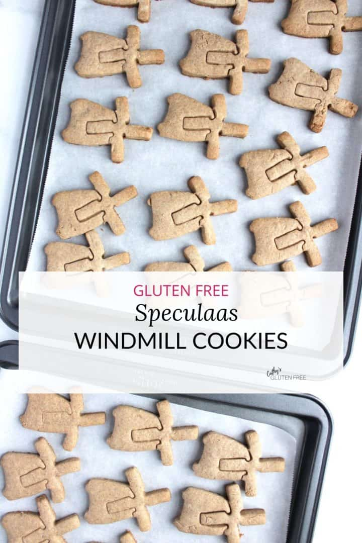 view from above of windmill-shaped cookies on parchment-lined baking sheets