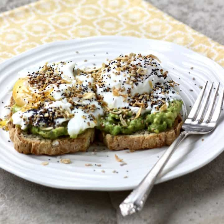 fried egg, avocado layered on toast