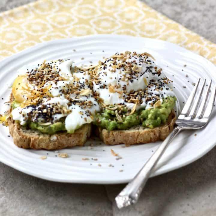 fried egg, avocado layered on toast