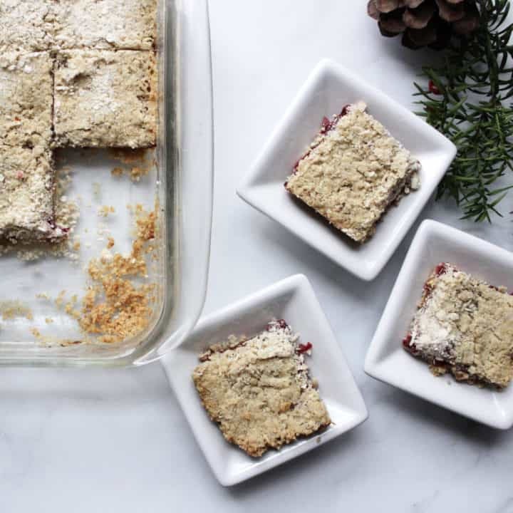 top down view of cut up squares of cranberry bars