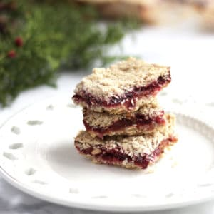 gluten free cranberry bars stacked on white plate