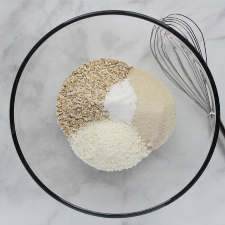 dry ingredients in glass bowl, whisk to side