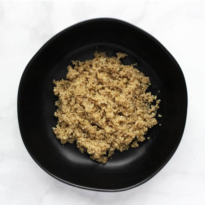 cooked quinoa in black bowl