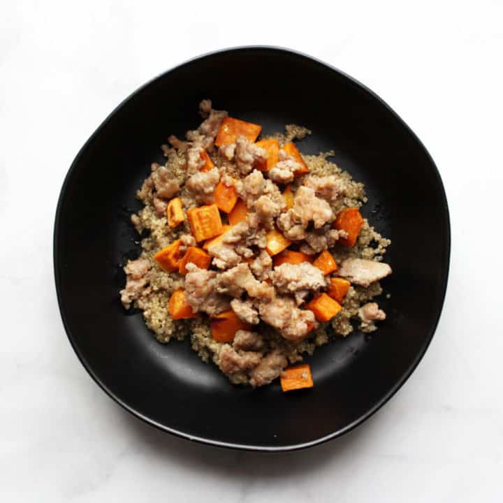 cooked bulk sausage with sweet potatoes on quinoa