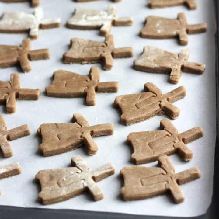 windmill-shaped cookies on baking sheet