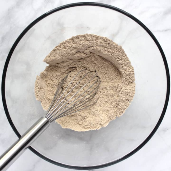 brownish flour mixture in bowl with whisk