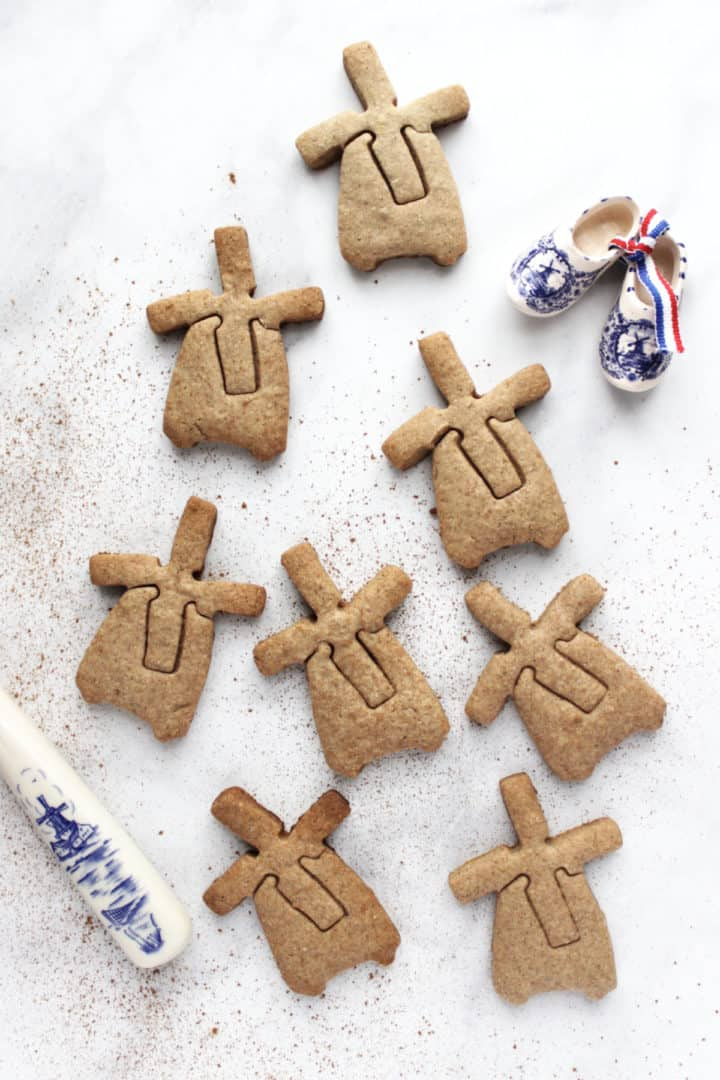 windmill-shaped cookies scattered over marble surface