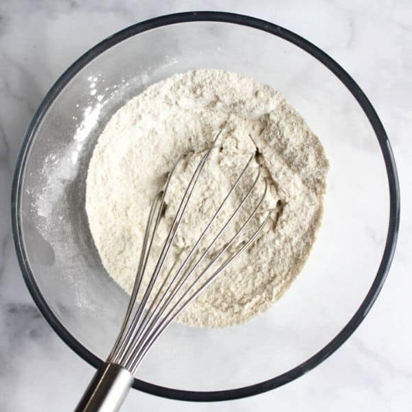 whisk in flour in glass bowl