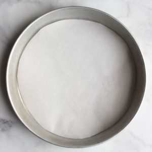 round pan lined with parchment paper