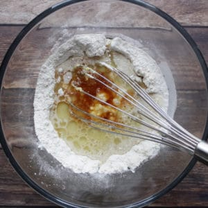 oil, vanilla, and egg in centre of flour