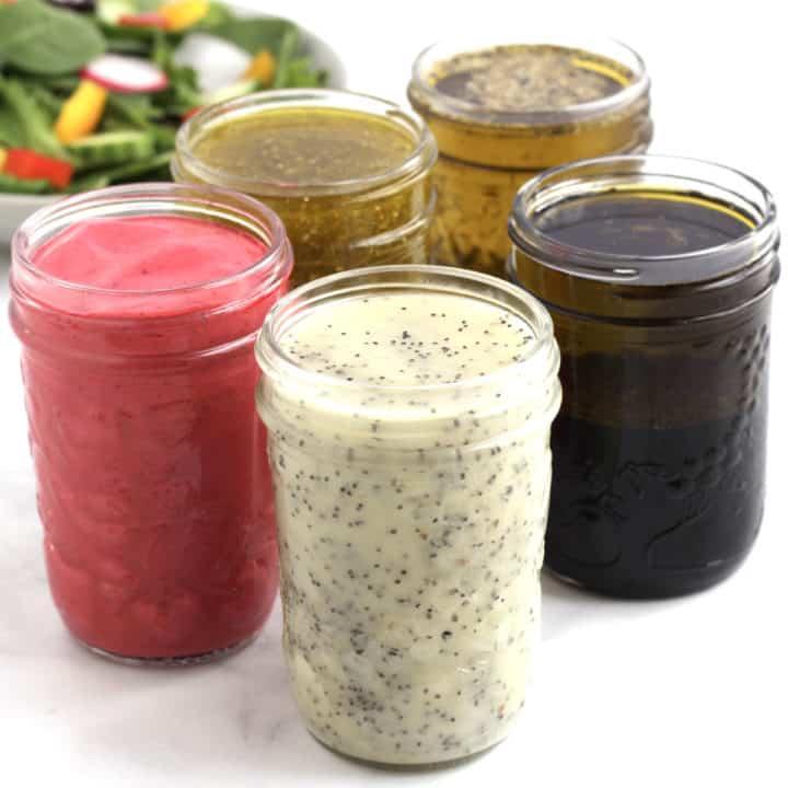 5 jars of salad dressing, pink, white, brown, golden
