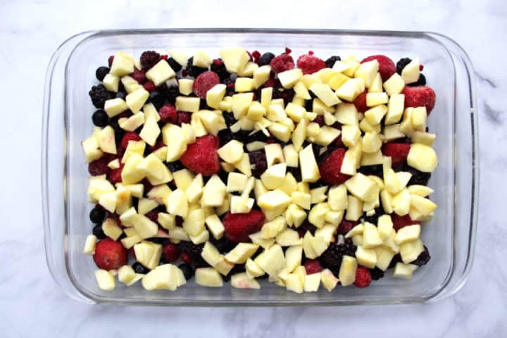 berries and chopped, peeled apples spread over bottom of pyrex baking pan