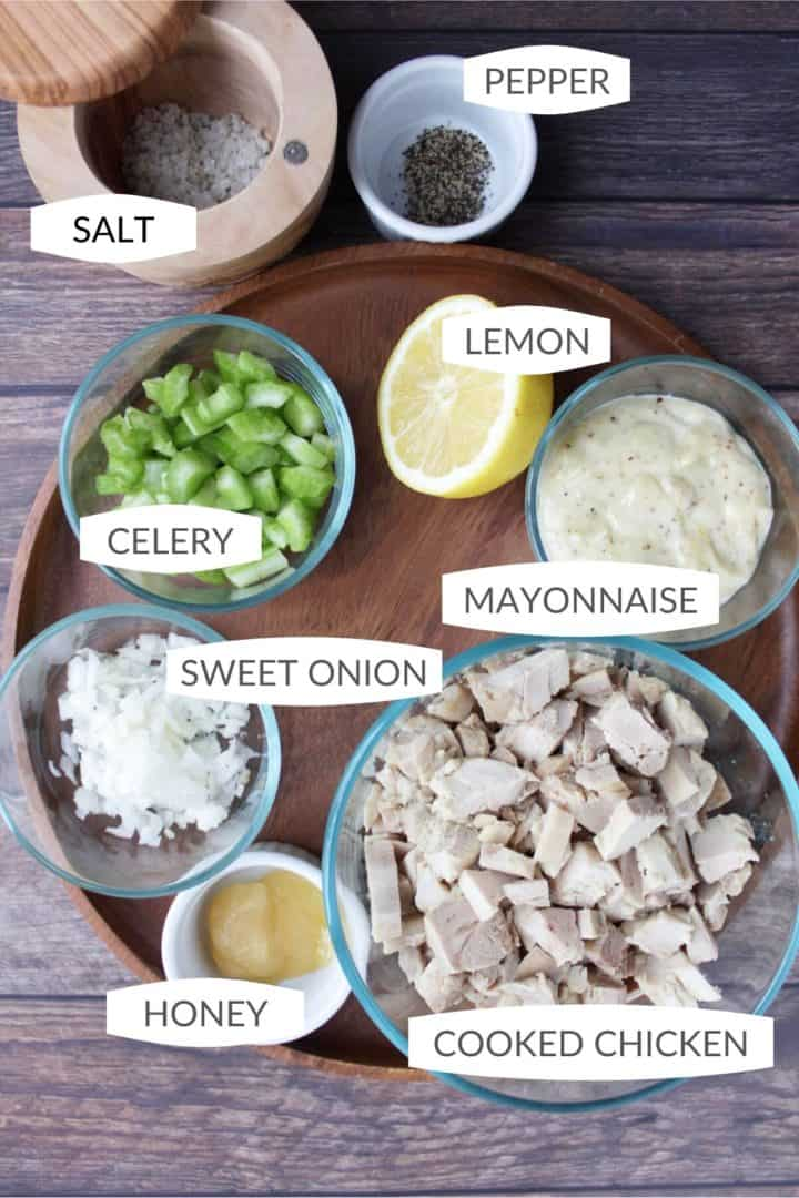 Salt, pepper, chopped celery, half lemon, mayonnaise, chopped onion, honey, and cubed, cooked chicken with labels