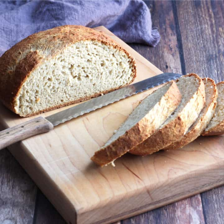 sliced round loaf of gluten free artisan bread, a component of frugal meals