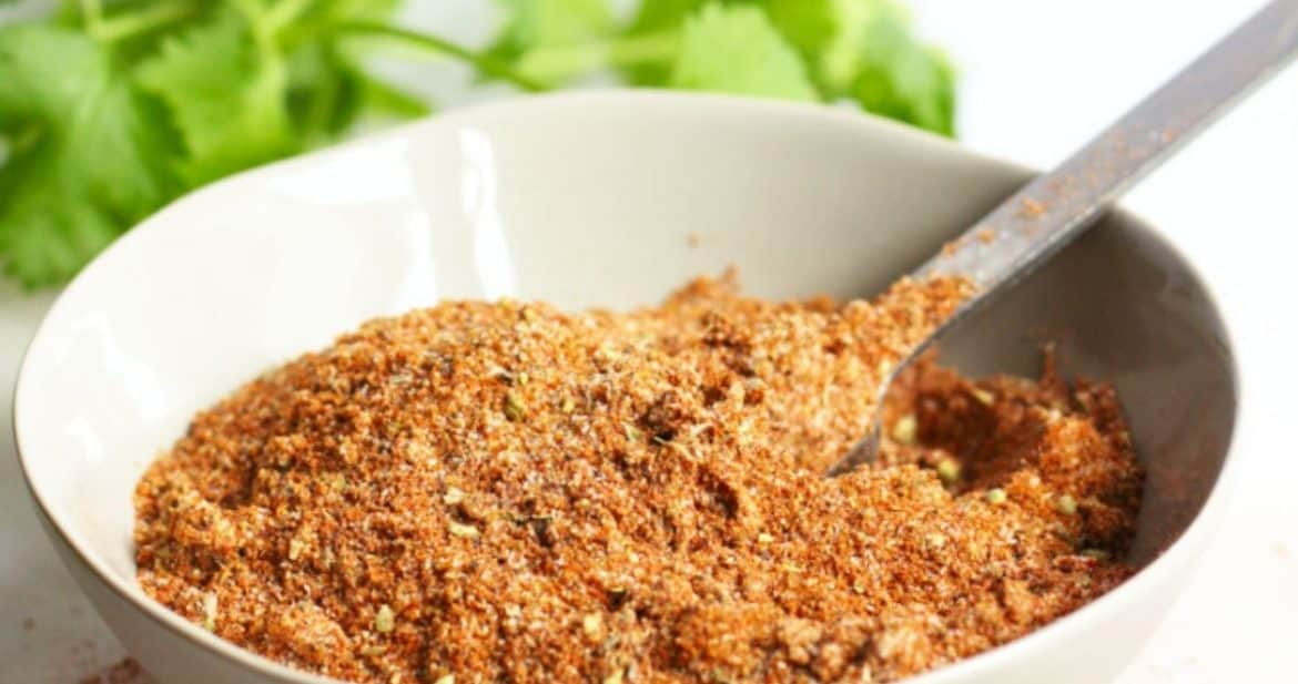 bowl of taco seasoning mix with spoon