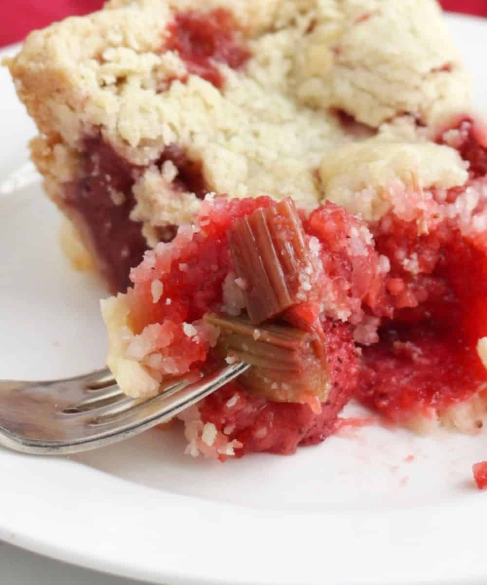 bite of gluten free strawberry rhubarb pie on fork