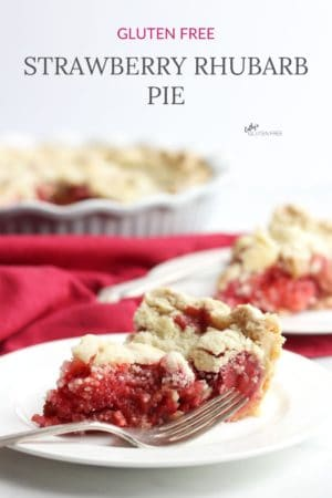 two slices of rhubarb strawberry pie on white plates, remaining pie in background, text