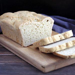 sliced gluten free bread on wooden board