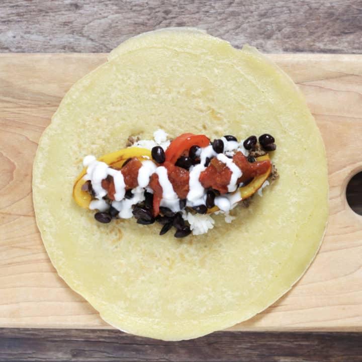 yogurt drizzled over burrito filling