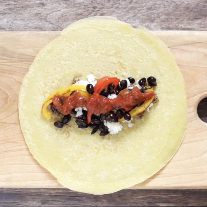 salsa spread across tortilla filling