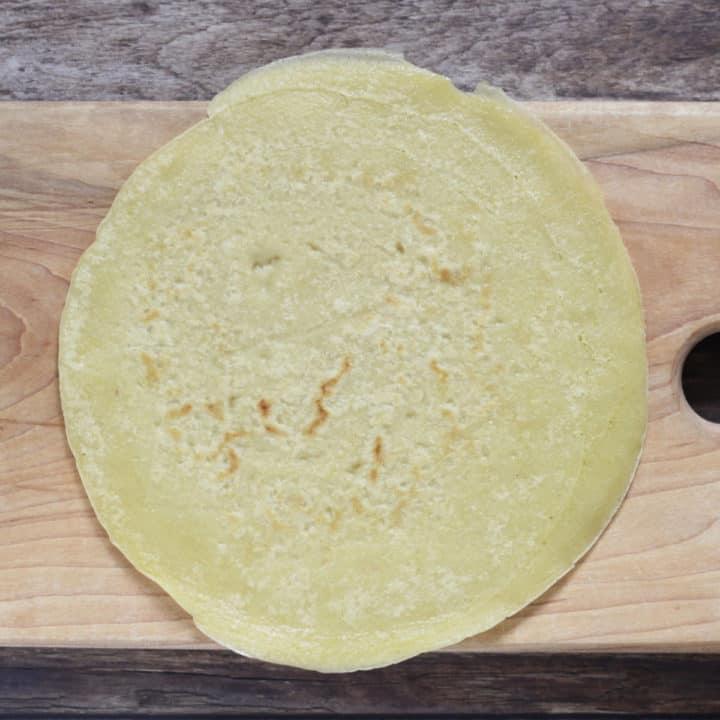 gluten free tortilla lying flat on wooden board
