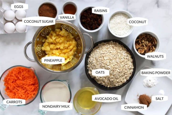 top-down view of ingredients for carrot cake overnight oatmeal laid out in small bowls with text overlay