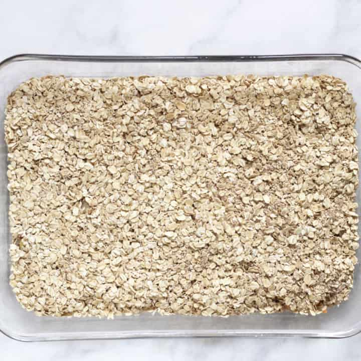 layer of oats in glass baking pan