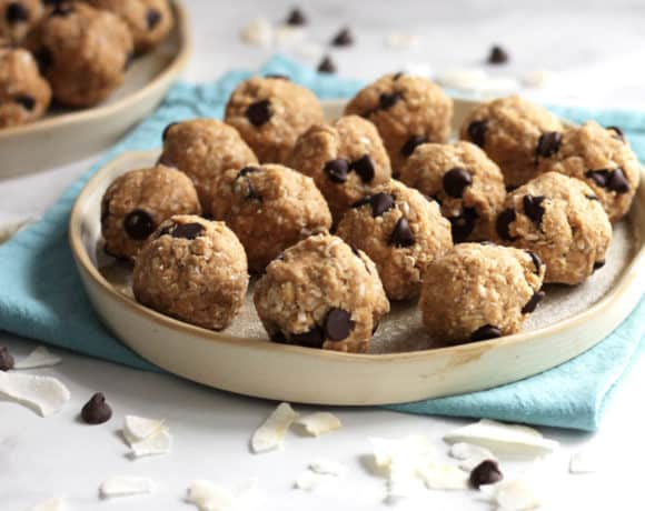 several peanut butter balls with chocolate chips on a plate