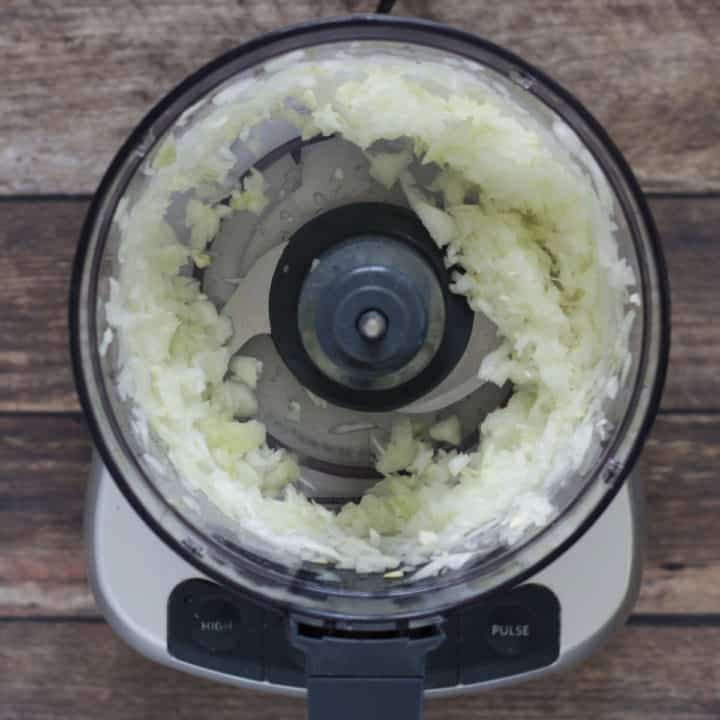 chopped onion in bowl of food processor