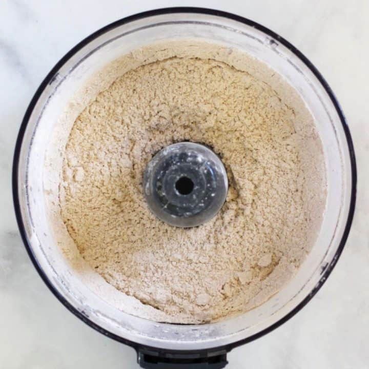 dry almond flour mixture in bowl of food processor