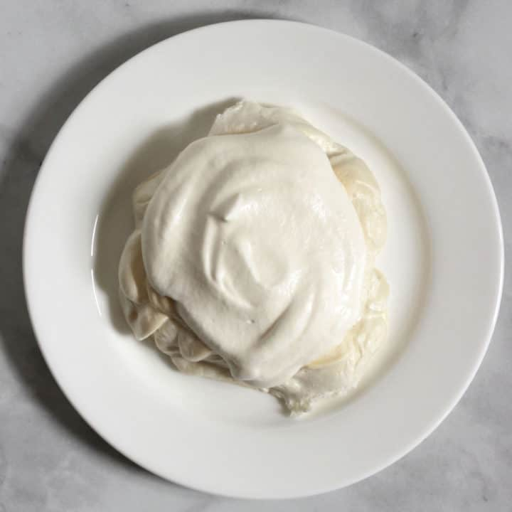 whipped cream mounded on top of baked meringue