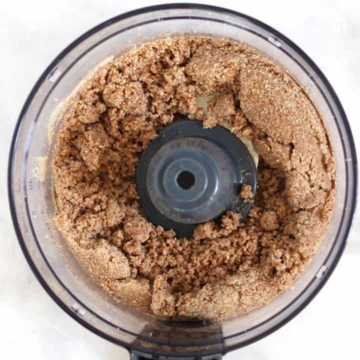 brown crumb mixture in bowl of food processor