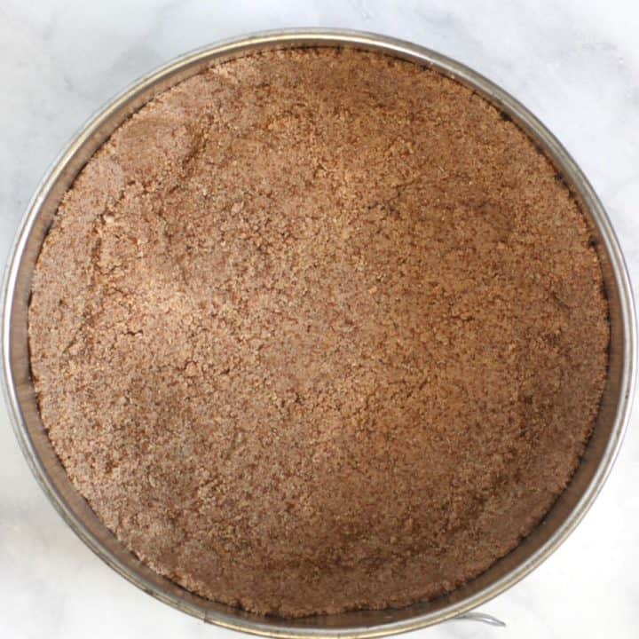 almond flour crust pressed into the bottom of a springform pan