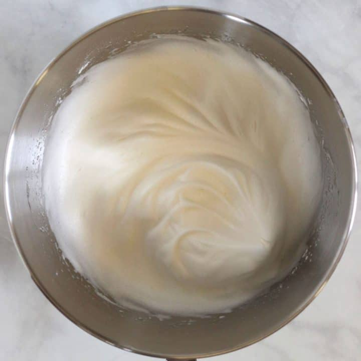 glossy, beaten egg whites in bowl of stand mixer