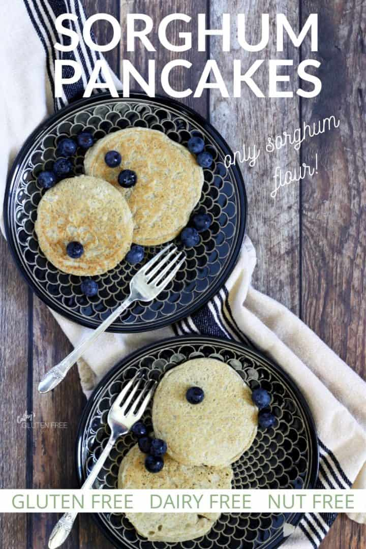 overhead view of two dark plates with two pancakes and blueberries on each, with text
