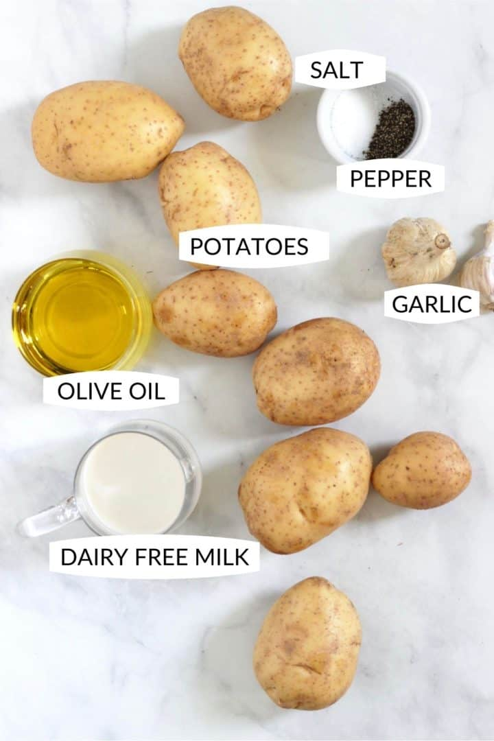 potatoes, garlic, olive oil, dairy-free milk, salt and pepper laid out with labels