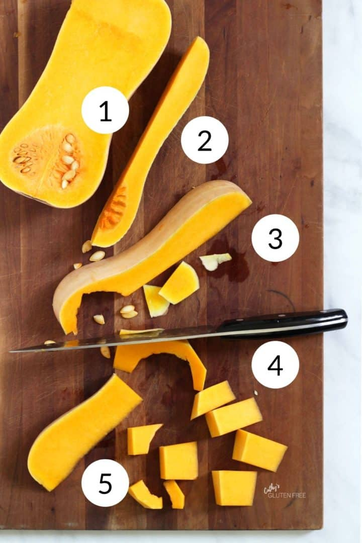 butternut squash cut open and spread out in various stages of peeling and chopping with a knife