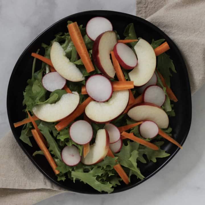 apple slices added on top of salad
