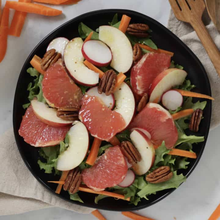 grapefruit salad glistening with drizzled salad dressing