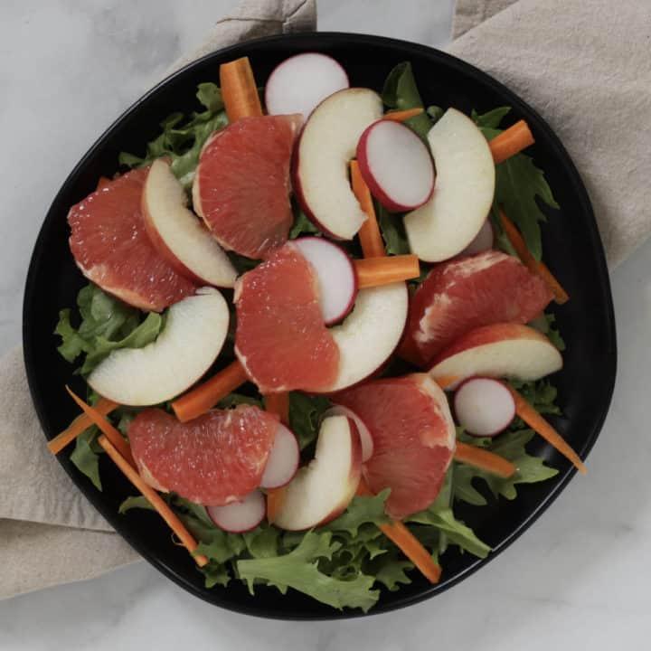 grapefruit segments arranged over top of salad